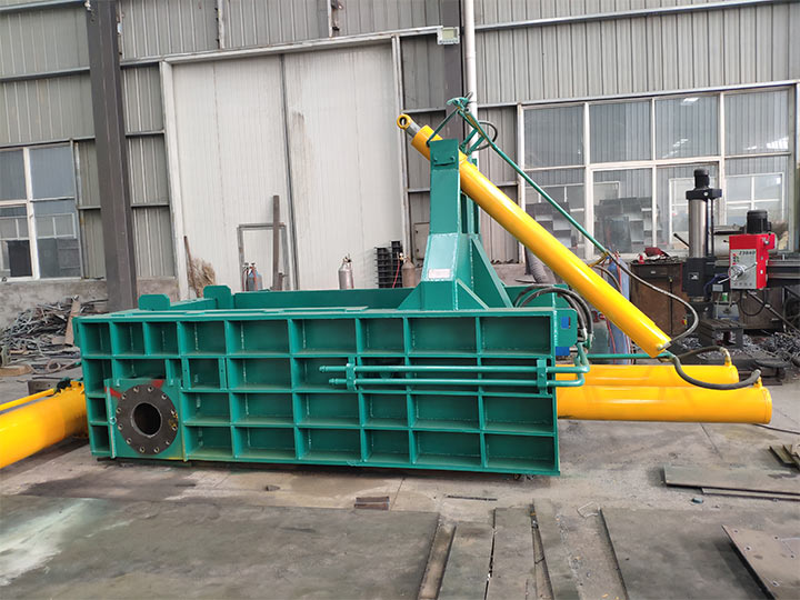 Scrap metal baler for recycling plant